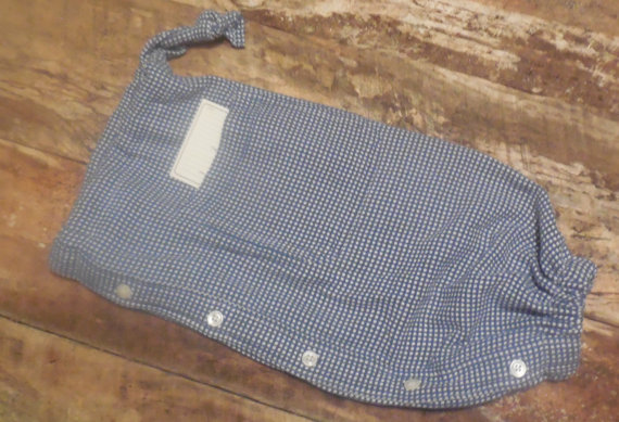This plastic bag holder is made from a cotton blend plaid shirt.